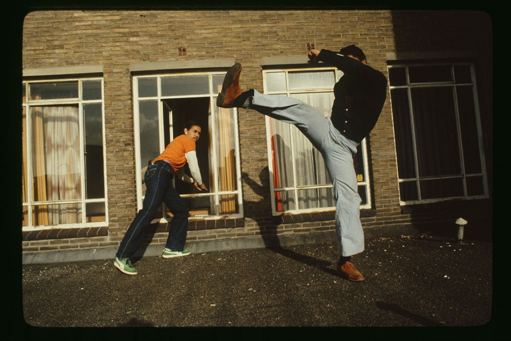 Lee Rozie and David Gordon practice martial arts on hotel roof, 1981