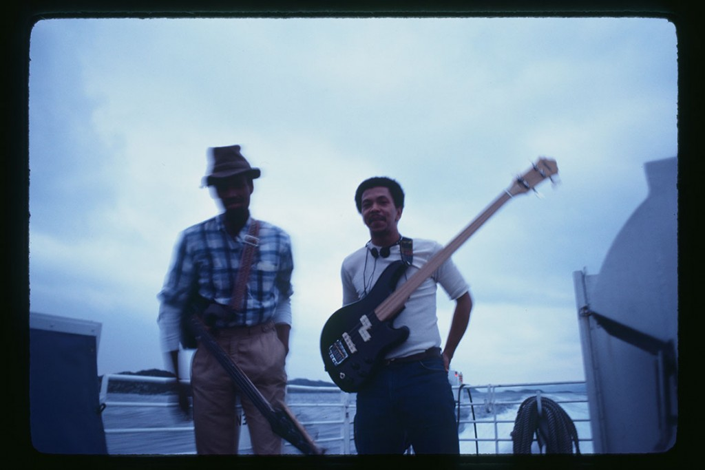 Melvin Gibbs and Bruce Johnson practice double bass parts on high speed ferry, Norway,1981