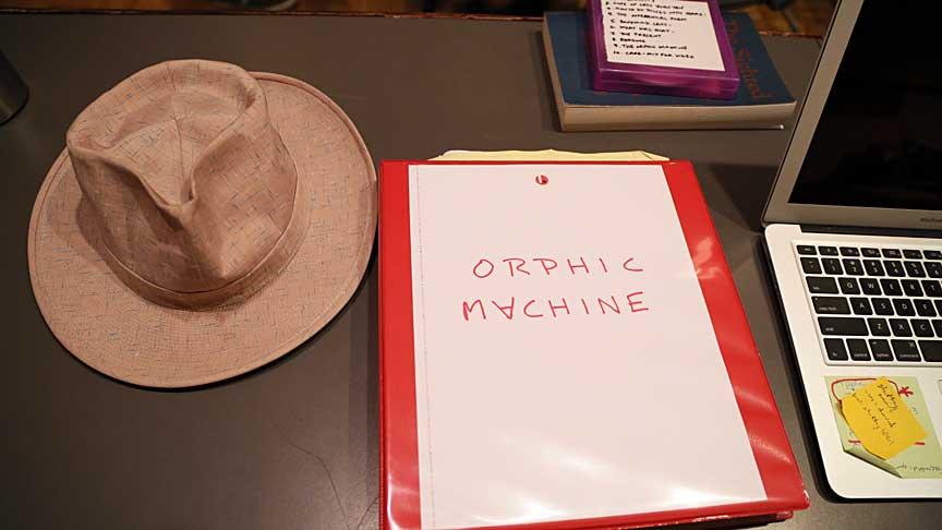 hat, binder, post-it note
